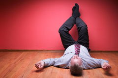 Men lying in the floor Stock Photos