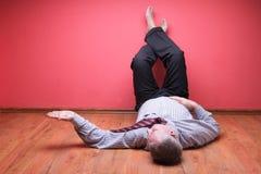 Men lying in the floor stock photos