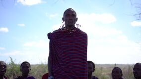 Maasai Tribe Men in Jumping Dance, Slowmotion. African Ethnic Group in Savannah