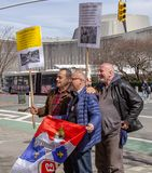 New York, NY / United States-Mar. 24, 2019: Demostrations for the 20th anniversary of NATO bombing of Serbia. Men making a speech in front of the United Nations royalty free stock photos