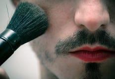 Transformation. Men making up himself Stock Photo