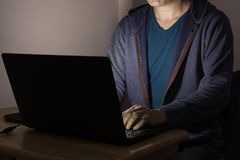 Men or Male Working or Playing Laptop Notebook Computer at Dark. Night as Late Working Concept Stock Images