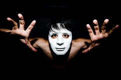 Men masked in darkness Stock Photo