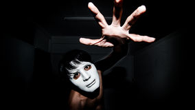Men masked in darkness Royalty Free Stock Photo