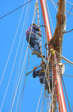 Men on masts Royalty Free Stock Photos