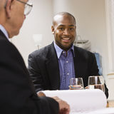 Men in Meeting at Office Stock Photo