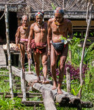 Men of the Mentawai tribe go hunting. MENTAWAI PEOPLE, WEST SUMATRA, SIBERUT ISLAND, INDONESIA – 03 OKTOBER 2011: Men of the Mentawai tribe go hunting royalty free stock image