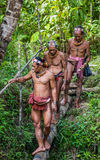 Men of the Mentawai tribe go hunting. MENTAWAI PEOPLE, WEST SUMATRA, SIBERUT ISLAND, INDONESIA – 03 OKTOBER 2011: Men of the Mentawai tribe go hunting royalty free stock photo
