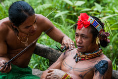 Men Mentawai tribe make tattoo. MENTAWAI PEOPLE, WEST SUMATRA, SIBERUT ISLAND, INDONESIA – 03 OKTOBER 2011: Men Mentawai tribe make tattoo royalty free stock image