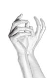 Men metal hands with long fingers on white Stock Images