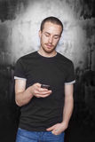 Men with mobile phone typing SMS Royalty Free Stock Image