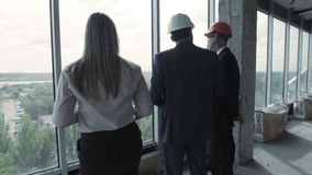 Men, moman in suit, hard hat and black man