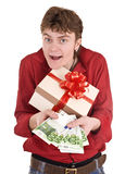 Men with money and gift box. Royalty Free Stock Images