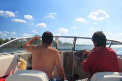 Men in a motor boat Stock Image