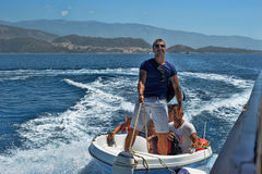 Men on a motor boat in the sea, Turkey Royalty Free Stock Image