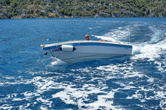 Men on a motor boat in the sea, Turkey Royalty Free Stock Photography