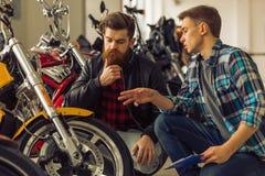 Men in motorbike salon Royalty Free Stock Photography