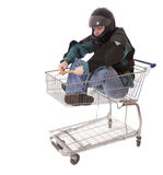 Men in motorcycle jacket in shopping cart Stock Image