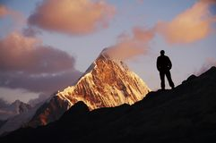 Men in mountain. Male on the sunrise in high mountain Stock Photography