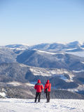 Men in the mountains looking forward. Royalty Free Stock Images