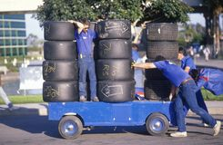 Men move a cart loaded with race car tires at the Toyota Grand Prix Race at the Indy Car World Series in Long Beach, CA Stock Photos