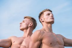Men muscular chest naked torso sky background. Men muscular athlete bodybuilder relaxing lean each other. Masculinity. And sexuality. Sexy torso attractive body royalty free stock photography