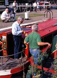 Men on narrowboats, Stoke Bruerne. Stock Photos