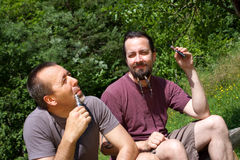 2 men in nature with e-cigarette Stock Photos