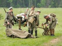 Men near the Maxim machine gun Stock Images