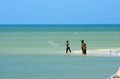 Men net fishing in ocean Royalty Free Stock Image