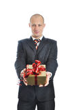 Men offering a gift isolated on white background Royalty Free Stock Photo