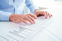 Men office worker typing on the keyboard. Male hands or man office worker typing on the keyboard Royalty Free Stock Photo