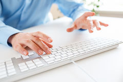 Men office worker typing on the keyboard. Male hands or man office worker typing on the keyboard Royalty Free Stock Images