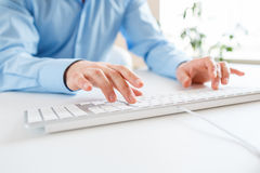 Men office worker typing on the keyboard Royalty Free Stock Image