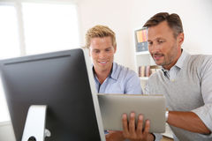 Men in office working together on project Stock Photography