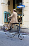 Men with old cycle,cycling through history event royalty free stock images