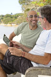 Men outdoors with tablet pc Stock Image