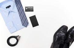 Men outfits with blue shirt. Clothes shop. Top view concept Royalty Free Stock Image