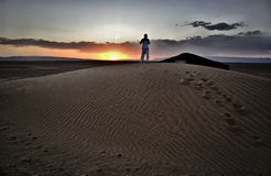 Men over dune Royalty Free Stock Photography