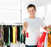 Men with packages shopping Stock Photos