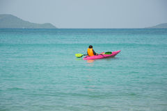 Men paddle kayak on the sea Stock Images