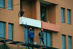 Men painting the balcony of a new house stock image