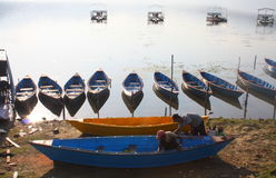 Men Painting Colourful Rowing Boats in Front of the Lake Pokhara Nepal Stock Photos