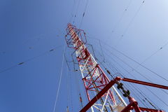 Men painting the highest Czech construction radio transmitter tower Liblice Royalty Free Stock Photography