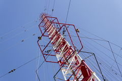 Men painting the highest Czech construction radio transmitter tower Liblice Stock Photo