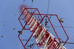 Men painting the highest Czech construction radio transmitter tower Liblice Royalty Free Stock Image