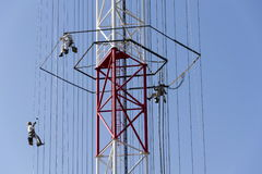 Men painting the highest Czech construction radio transmitter tower Liblice Royalty Free Stock Photo