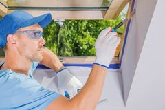 Men Painting His Room. Caucasian Men Painting His Room. Finishing Roof Window Edges. Room Painter Theme royalty free stock photography