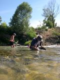Men panning for gold. Royalty Free Stock Photo