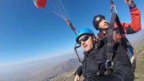 Men Paragliding above mountain Stock Photos